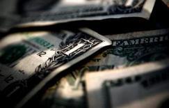 <p>Une Américaine a défié les lois de probabilités en remportant à deux reprises lors d'un même tirage de loterie la somme d'un million de dollars (760.000 euros). /Photo d'archives/REUTERS</p>