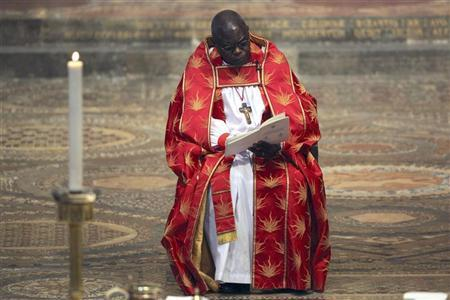 Archbishop of York, John Sentamu, sits near the high altar during the ninth Inauguration of the General Synod at Westminster Abbey, in central London November 23, 2010. REUTERS/Dan Kitwood/Pool