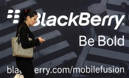 A woman uses her mobile phone at the Blackberry World Event in Orlando May 1, 2012. RREUTERS/David Manning