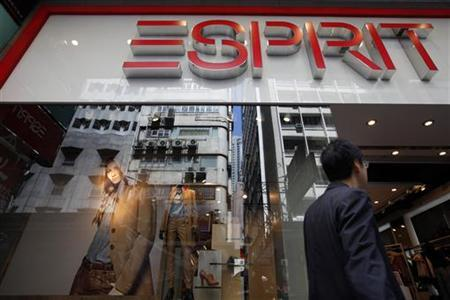 A man walks past an Esprit store in Hong Kong's central financial district September 15, 2011. REUTERS/Tyrone Siu