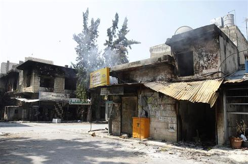 Syrian town burned, abandoned
