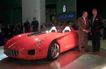 Ferrari's ''Rossa'' is is unveiled by engineer Sergio Pininfarina (L) and Ferrari Chairman Luca Cordero di Montezemolo at the international Turin Motor Show.