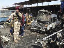 <p>موقع انفجار في كربلاء يوم الثلاثاء - رويترز</p>
