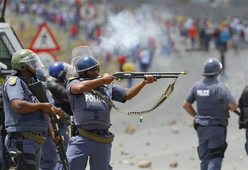 Police fire at striking workers