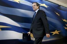 Le Premier ministre grec, Antonis Samaras. La Grèce annonce mardi avoir conclu, après six mois de négociations, un accord avec ses bailleurs de fonds internationaux permettant le déblocage de la prochaine tranche du plan d'aide international qui la maintient à flot. /Photo prise le 18 mars 2014/REUTERS/Yorgos Karahalis