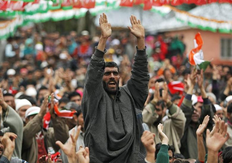 A supporter of Kashmir's ruling National Conference (NC) party shout slogans during an election campaign rally addressed by Kashmir's chief minister Omar Abdullah (unseen), at Duroo, south of Srinagar April 21, 2014. REUTERS/Danish Ismail