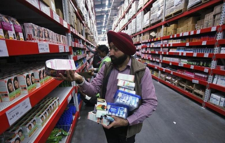 A customer shops at a Best Price Modern Wholesale store, a joint venture of Wal-Mart Stores Inc and Bharti Enterprises, at Zirakpur in Punjab December 6, 2012. REUTERS/Ajay Verma/files