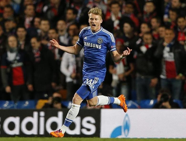 Chelsea's Andre Schuerrle celebrates after scoring the first goal for the team during their Champions League quarter-final second leg soccer match against Paris St Germain at Stamford Bridge in London, April 8, 2014.                       REUTERS/Stefan Wermuth