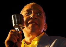 Juan Formell, band leader and bassist of Cuba's salsa band Los Van Van, performs during a concert in Havana January 15, 2010. REUTERS/Stringer