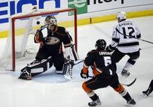 May 5, 2014; Anaheim, CA, USA; Los Angeles Kings right wing Marian Gaborik (12) scores a goal past Anaheim Ducks goalie Jonas Hiller (1) during the first period in game two of the second round of the 2014 Stanley Cup Playoffs at Honda Center.  Richard Mackson-USA TODAY Sports