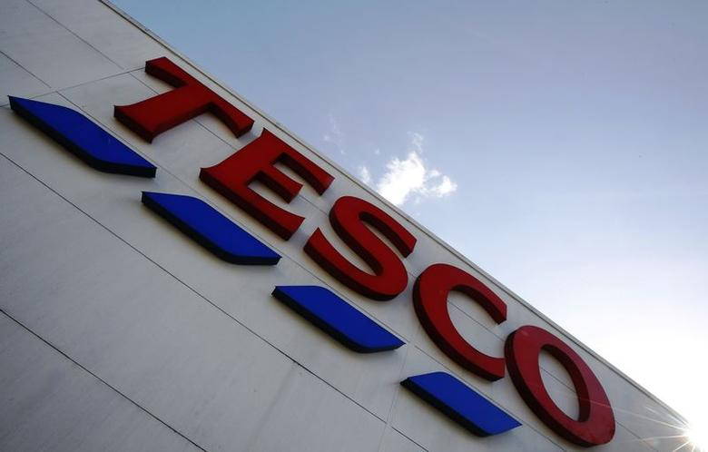 A store sign is seen outside a Tesco supermarket in London April 15, 2014. REUTERS/Luke MacGregor/Files