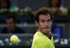 Andy Murray of Britain eyes the ball before returning it to Nicolas Almagro of Spain during their match at the Madrid Open tennis tournament May 7, 2014. REUTER/Susana Vera