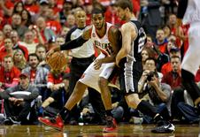May 10, 2014; Portland, OR, USA; Portland Trail Blazers forward LaMarcus Aldridge (12) defends San Antonio Spurs center Tiago Splitter (22) in game three of the second round of the 2014 NBA Playoffs at the Moda Center. Mandatory Credit: Craig Mitchelldyer-USA TODAY Sports