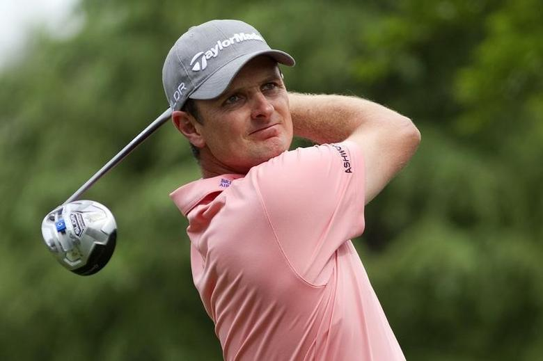 May 1, 2014; Charlotte, NC, USA; Justin Rose tees off on the eleventh hole during the first round of the Wells Fargo Championship at Quail Hollow Club. Mandatory Credit: Joshua S. Kelly-USA TODAY Sports
