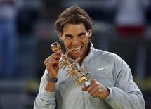 Rafael Nadal of Spain poses with the Ion Tiriac trophy after his victory over Kei Nishikori of Japan in their men's singles final match at the Madrid Open tennis tournament May 11, 2014.  REUTERS/Susana Vera