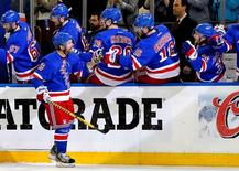 May 11, 2014; New York, NY, USA; New York Rangers right wing Martin St. Louis (26) is congratulated after scoring a first period goal against the Pittsburgh Penguins in game six of the second round of the 2014 Stanley Cup Playoffs at Madison Square Garden.  Andy Marlin-USA TODAY Sports - RTR3OPHN