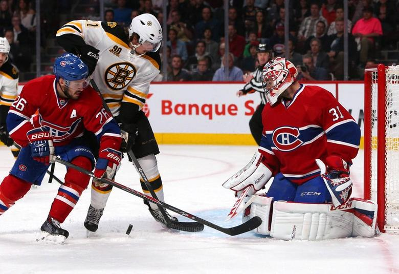 May 12, 2014; Montreal, Quebec, CAN; Boston Bruins left wing Loui Eriksson (21) is unable to get the puck past Montreal Canadiens goalie Carey Price (31) and defenseman Josh Gorges (26) during the second period in the game six of the second round of the 2014 Stanley Cup Playoffs at Bell Centre. Jean-Yves Ahern-USA TODAY Sports