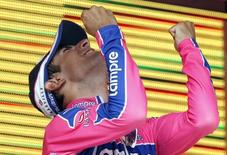 Lampre rider Diego Ulissi of Italy celebrates on the podium after the 230 km (143 miles) 17th stage of the Giro d'Italia cycling race from Feltre to Tirano May 25, 2011. REUTERS/Stefano Rellandini