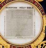 A 1.5 inch by 1.5 inch (3.8 cm by 3.8 cm) microfilm Bible which can be read with the help of a microscope is seen in an undated handout picture from Heritage Auctions.  REUTERS/Heritage Auctions/Handout