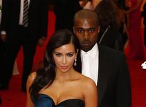 "Kim Kardashian and Kanye West arrive at the Metropolitan Museum of Art Costume Institute Gala Benefit celebrating the opening of ""Charles James: Beyond Fashion"" in Upper Manhattan, New York, May 5, 2014.  REUTERS/Lucas Jackson"
