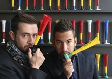 "Belgian entrepreneurs Fabio Lavalle (L) and David Dos Santos pose with the ""diabolica"" trumpet in Mons May 16, 2014. REUTERS/Francois Lenoir"