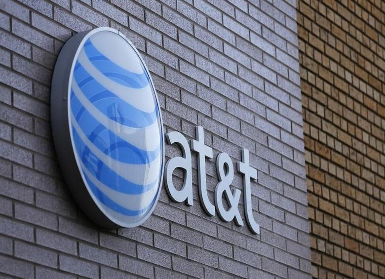An AT&T sign is shown on a building in downtown San Diego, California March 18, 2014. REUTERS/Mike Blake/Files