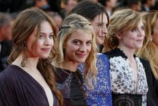 """(L-R) Actresses Lou de Laage, Melanie Laurent, Josephine Japy, and Isabelle Carre pose on the red carpet as they arrive for the screening of the film """"The Homesman"""" in competition at the 67th Cannes Film Festival in Cannes May 18, 2014.                 REUTERS/Yves Herman"""