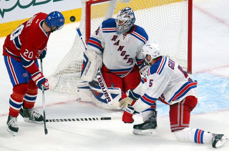 May 19, 2014; Montreal, Quebec, CAN; Montreal Canadiens left wing Thomas Vanek (20) misses a chance to score a goal against New York Rangers goalie Henrik Lundqvist (30) as defenseman Dan Girardi (5) defends during the third period in game two of the Eastern Conference Finals of the 2014 Stanley Cup Playoffs at Bell Centre. Jean-Yves Ahern-USA TODAY Sports