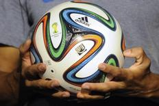 "The official match ball for the 2014 World Cup named ""Brazuca"" is presented in Rio de Janeiro December 3, 2013. REUTERS/Stringer"
