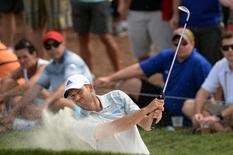 May 10, 2014; Ponte Vedra Beach, FL, USA; Sergio Garcia plays from a bunker on the 9th hole during the third round of The Players Championship at TPC Sawgrass - Stadium Course. Mandatory Credit: John David Mercer-USA TODAY Sports