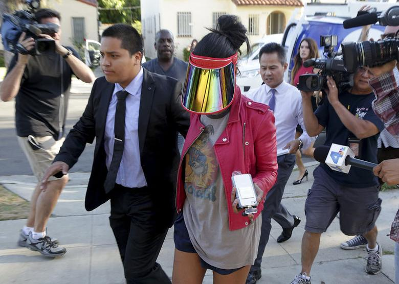Model who uses the name V. Stiviano walks outside her home in Los Angeles, California April 28, 2014. REUTERS/Jonathan Alcorn