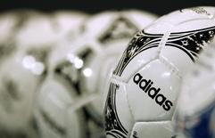 Footballs from Adidas, the world's second largest sports apparel firm, are displayed before the company annual general meeting in the northern Bavarian town of Fuerth near Nuremberg May 8, 2014.  REUTERS/Michaela Rehle