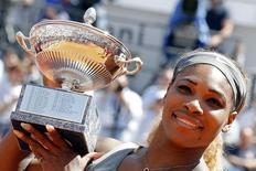 Serena Williams of the U.S. poses with the trophy after winning her women's singles final match against Sara Errani of Italy at the Rome Masters tennis tournament May 18, 2014. REUTERS/Giampiero Sposito