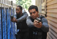 "Cassius Green (RZA, L) and Ryan Lopez (Ramon Rodriguez, R) pursue shooting suspects in the ""Sangre Por Sangre"" episode of Gang Related on FOX. REUTERS/FOX/Richard Foreman"