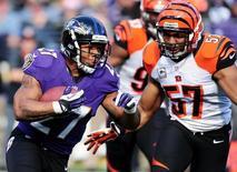 Nov 10, 2013; Baltimore, MD, USA; Baltimore Ravens running back Ray Rice (27) runs with the ball as Cincinnati Bengals linebacker Vincent Rey (57) defends at M&T Bank Stadium. Mandatory Credit: Evan Habeeb-USA TODAY Sports