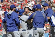 May 25, 2014; Philadelphia, PA, USA; Los Angeles Dodgers starting pitcher Josh Beckett (61) is mobbed by his teammates after throwing a no-hitter against the Philadelphia Phillies at Citizens Bank Park.    Eric Hartline-USA TODAY Sports