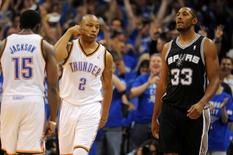 May 25, 2014; Oklahoma City, OK, USA; Oklahoma City Thunder forward Caron Butler (2) reacts after making a 3 point shot against the San Antonio Spurs during the third quarter in game three of the Western Conference Finals of the 2014 NBA Playoffs at Chesapeake Energy Arena. Mandatory Credit: Mark D. Smith-USA TODAY Sports