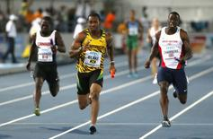 Jamaica's Yohan Blake (C) crosses the finish line ahead of Britain's Dwain Chambers (R) and Canada's Justyn Warner (L) to win the men's 4x100 metres relay during the IAAF World Relays Championships in Nassau, Bahamas, May 25, 2014. REUTERS/Mike Segar