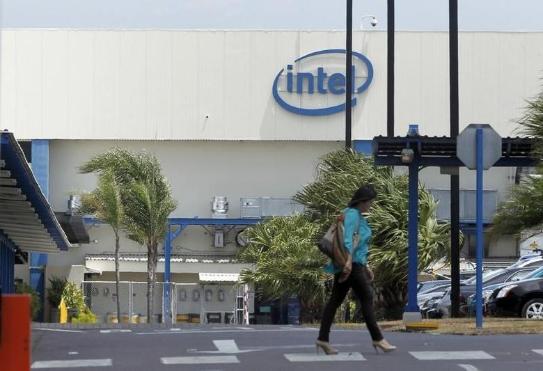 An employee walks inside the Intel microprocessor assembly plant, in Heredia, north of San Jose, April 9, 2014. REUTERS/Juan Carlos Ulate/Files
