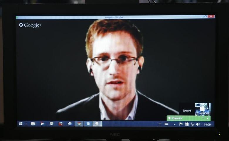 Accused government whistleblower Edward Snowden is seen on a screen as he speaks via video conference with members of the Committee on legal Affairs and Human Rights of the Parliamentary Assembly of the Council of Europe during an hearing on ''mass surveillance'' at the Council of Europe in Strasbourg, April 8, 2014. REUTERS/Vincent Kessler/Files