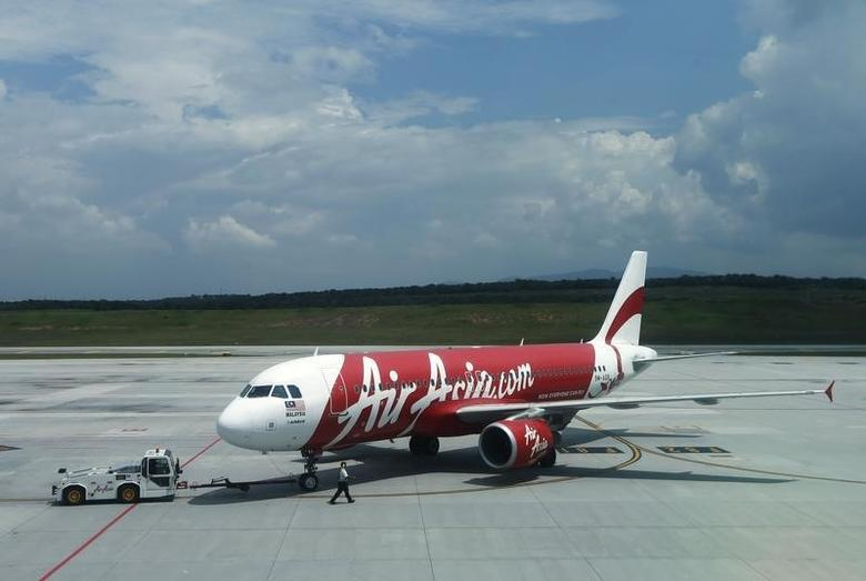 Air Asia aircraft model 9M-AQB is seen on track at Low Cost Carrier Terminal (LCCT) airport at Sepang outside Kuala Lumpur November 19, 2013. REUTERS/Samsul Said/Files