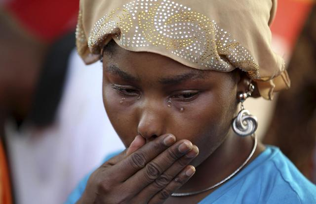 A protester cries during a sit-in rally for the abducted schoolgirls, at the Unity Fountain in Abuja in this May 15, 2014 file photo.  REUTERS/Afolabi Sotunde/Files