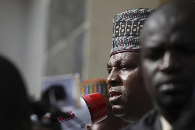 Kashim Shettima, the governor of Borno state, addresses a protest rally by Nigerians demanding the release of the school girls abducted from the remote village of Chibok, in Asokoro, Abuja in this May 13, 2014 file photo. REUTERS/Afolabi Sotunde/Files