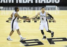 May 29, 2014; San Antonio, TX, USA; San Antonio Spurs guard Danny Green (4) celebrates with forward Kawhi Leonard (2) against the Oklahoma City Thunder during the second half in game five of the Western Conference Finals of the 2014 NBA Playoffs at AT&T Center. Mandatory Credit: Brendan Maloney-USA TODAY Sports