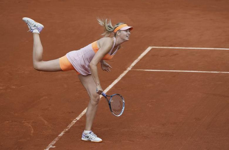 Maria Sharapova of Russia competes in her women's singles match against Paula Ormaechea of Argentina at the French Open tennis tournament at the Roland Garros stadium in Paris May 30, 2014.       REUTERS/Gonzalo Fuentes