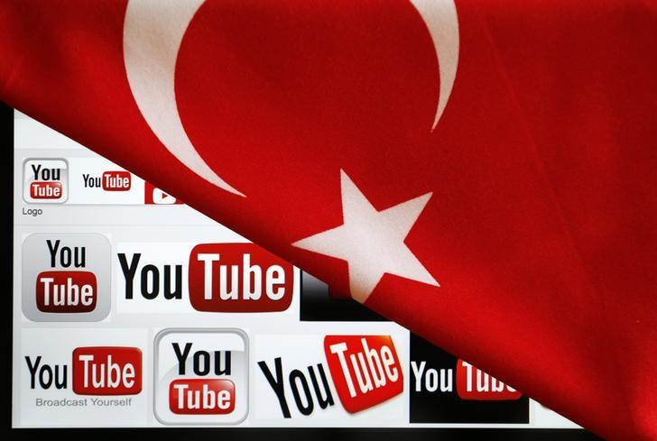 YouTube logos displayed on a laptop screen partially covered with Turkey's national flag in this photo illustration taken in Ankara March 27, 2014.  REUTERS/Umit Bektas