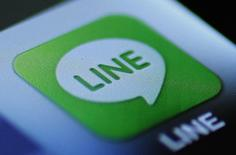 """The icon of a free communication app """"Line"""" is pictured on an Apple Inc's iPhone in this photo illustration in Tokyo August 14, 2012. REUTERS/Yuriko Nakao"""