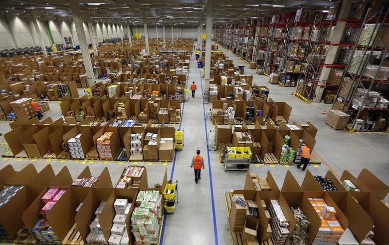 Work is carried out at Amazon's logistics centre in Graben near Augsburg December 17, 2012.  REUTERS/Michael Dalder/Files