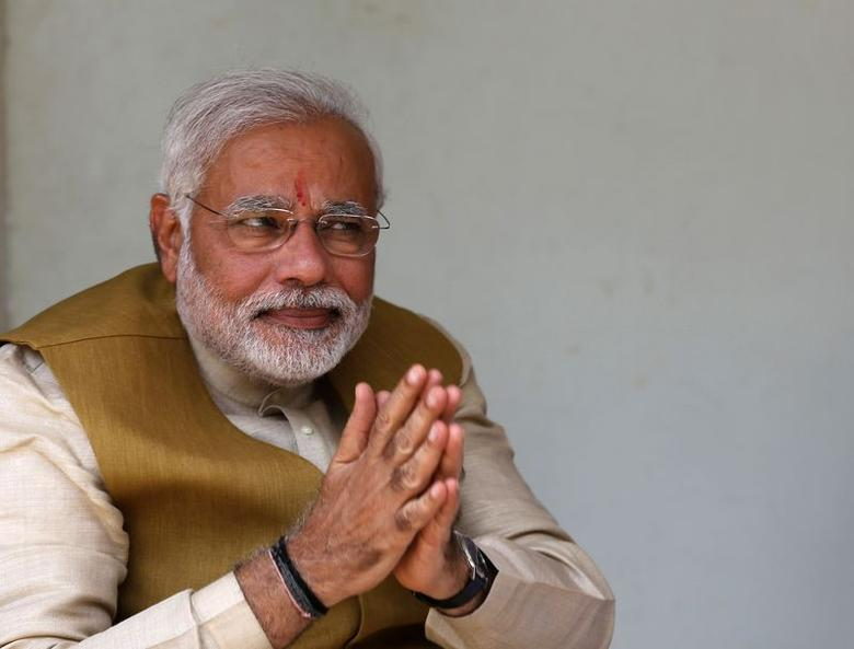 Narendra Modi gestures after seeking blessings from his mother Heeraben at her residence in Gandhinagar in Gujarat May 16, 2014. REUTERS/Amit Dave/Files