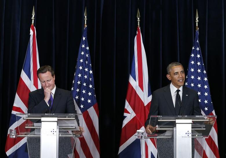 Britain's Prime Minister David Cameron (L) and U.S. President Barack Obama (R) hold a joint news conference at the end of a G7 leaders meeting at European Council headquarters in Brussels June 5, 2014. REUTERS/Yves Herman